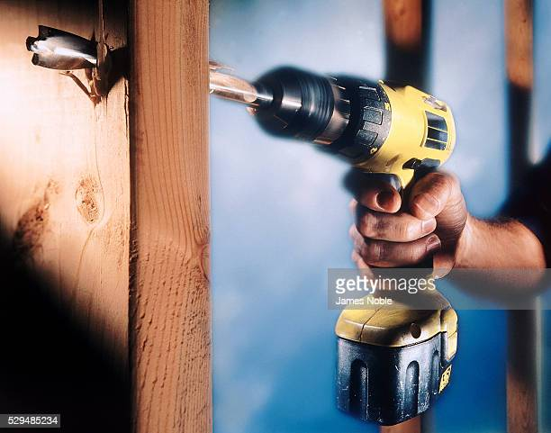 drilling through the wood - drill stock pictures, royalty-free photos & images