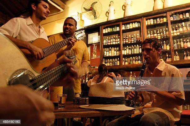 Drink and music at Mangue Seco restaurant and cachaçaria at Lapa district in Rio de Janeiro Brazil musicians of the group Cozinha Brasileira playing...