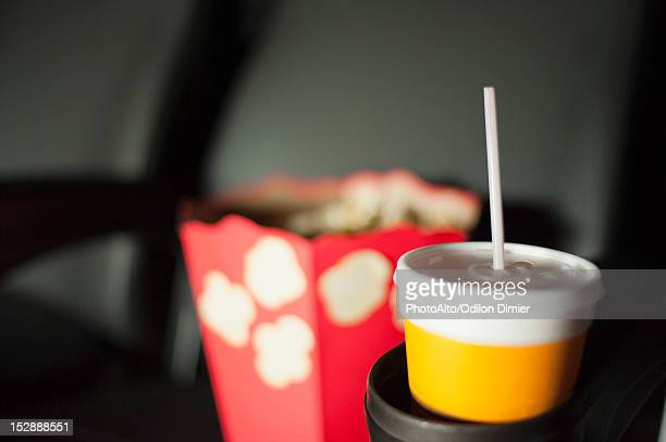 Drink and popcorn in movie theater