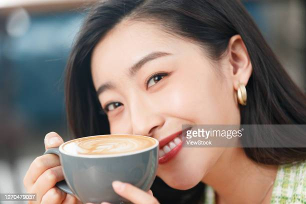 drink coffee young woman - coffee drink stock pictures, royalty-free photos & images