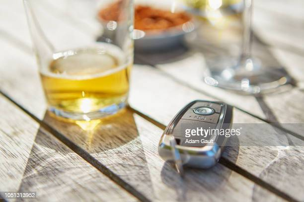 drink driving car key and glass of beer - drinking and driving stock photos and pictures