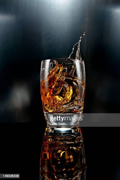 Drink ice cube splash on black