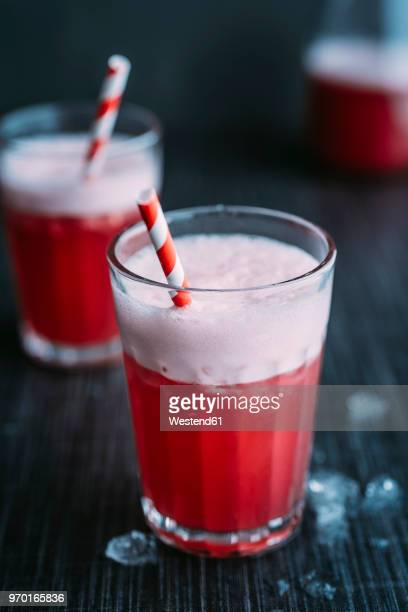 Drink: Switchel, drink with ginger, apple vinegar, coconut water, cranberry juice, lemon, cruched ice, honey