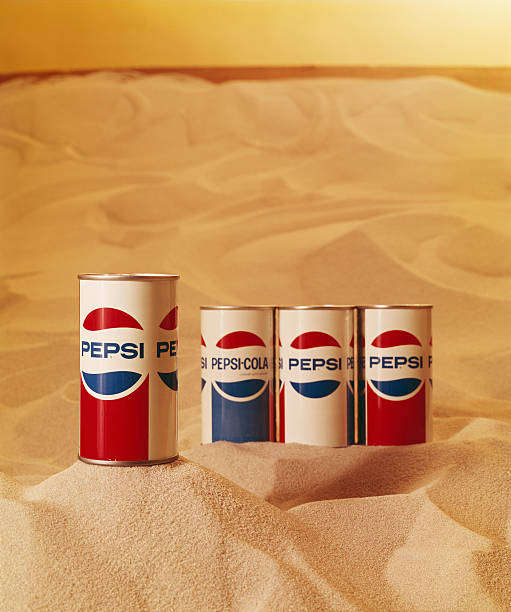 Drink tins on sand, close-up