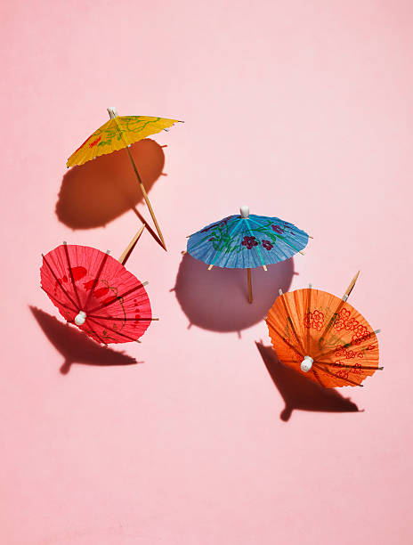 Drink Umbrellas On Pink Wall Art