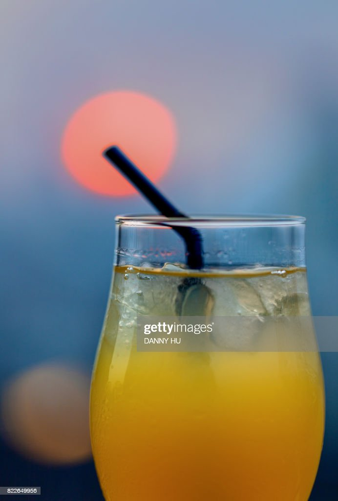drink with city skyline and sunset : Stock Photo