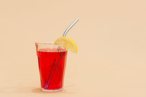 Drink with reusable stainless steel straw in red drink - gettyimageskorea