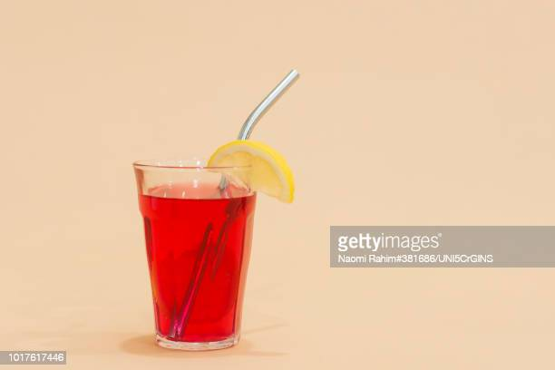 drink with reusable stainless steel straw in red drink - drinking straw stock pictures, royalty-free photos & images