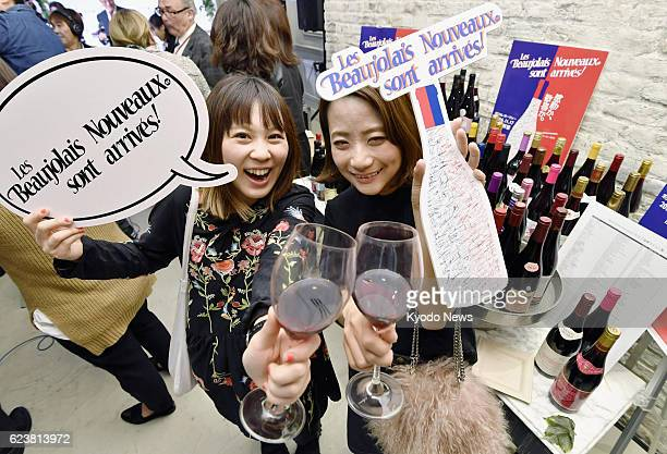Drinkers raise glasses of Beaujolais Nouveau on Nov 2016 immediately after the French wine was released at an event in Tokyo