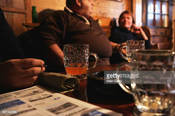 Drinkers relax in Tucker's Grave a traditional cider pub February 5 Faulkland Somerset England Regulars in the pub known for its stong rough cider...