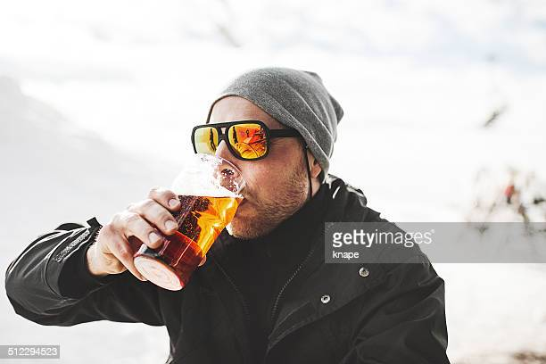 Drinking a beer at after ski