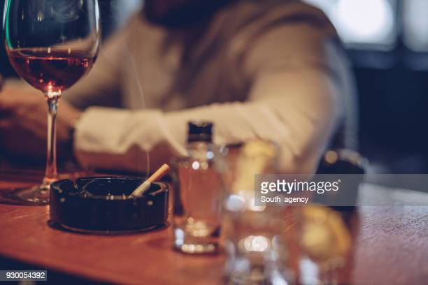 drinking all day - cigarette stock pictures, royalty-free photos & images