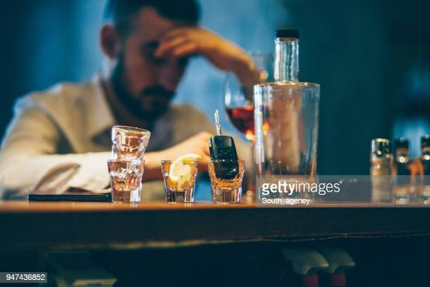 drinking alone - alcohol abuse stock pictures, royalty-free photos & images