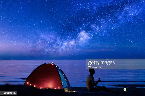 drinking alone under the stars - fujian province stock pictures, royalty-free photos & images