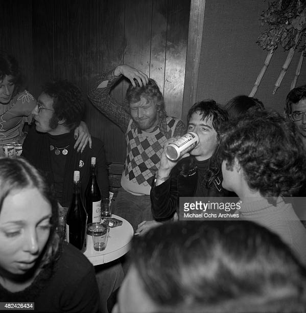 Drinking buddies known as 'The Hollywood Vampires' LR John Lennon Harry Nilsson Alice Cooper and Micky Dolenz celebrate an early Thanksgiving...