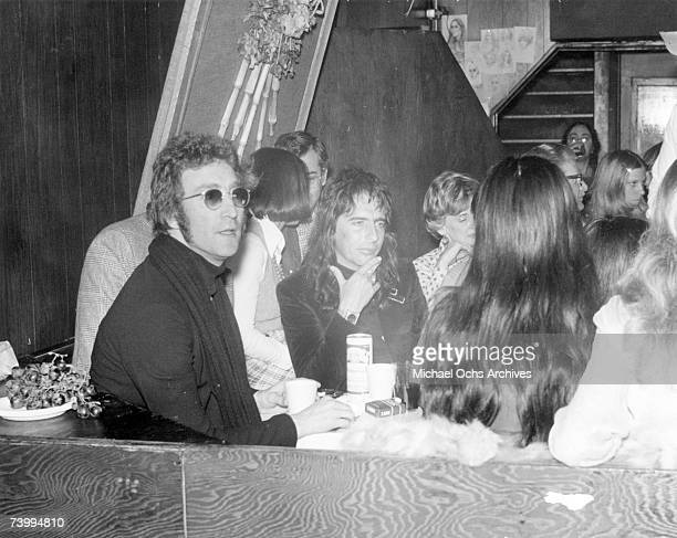 Drinking buddies known as 'The Hollywood Vampires' LR John Lennon Harry Nilsson and Alice Cooper celebrate an early Thanksgiving watching singer Anne...