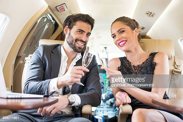Drinking champagne in private jet airplane