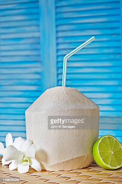 Drinking coconut with a straw