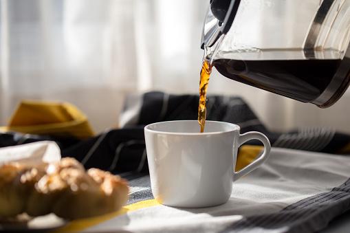 drinking coffee at breakfast 903694512