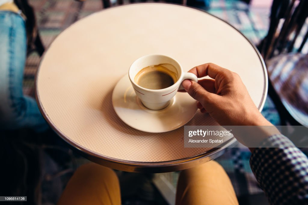 Drinking coffee at the cafe, personal perspective view : Stock Photo