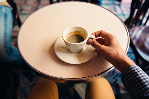 Drinking coffee at the cafe, personal perspective view - gettyimageskorea
