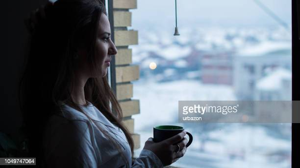 Drinking Coffee By The Window in Winter