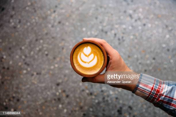 drinking coffee from a cup, personal perspective directly above view - al centro foto e immagini stock