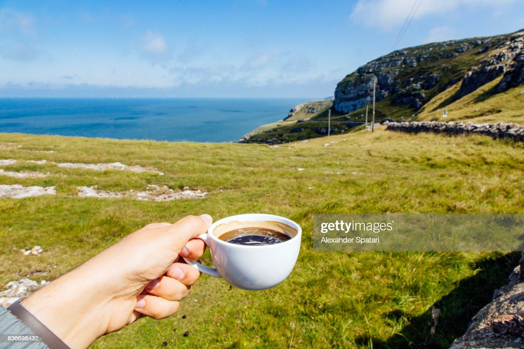 Drinking coffee from personal perspective and enjoying the view at Great Orme, Llandudno : Stock Photo