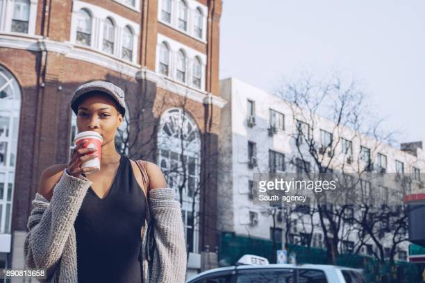 Drinking coffee on the street