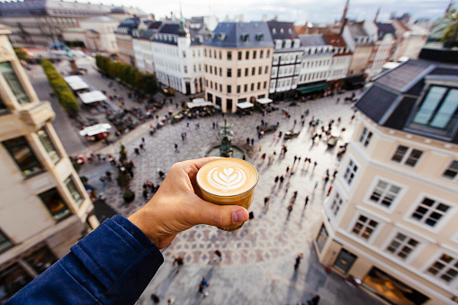 Drinking coffee personal perspective view with high angle view of Amagertorv square in Copenhagen, Denmark - gettyimageskorea
