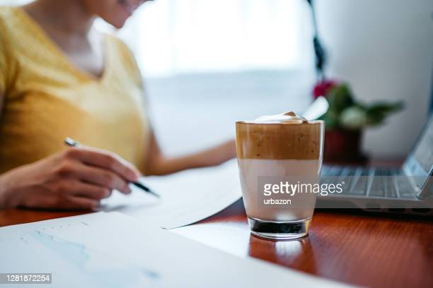 drinking dalgona coffee and working - dalgona stock pictures, royalty-free photos & images