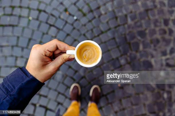drinking espresso on the cobbled streets of rome, personal perspective view, rome, italy - espresso stock pictures, royalty-free photos & images