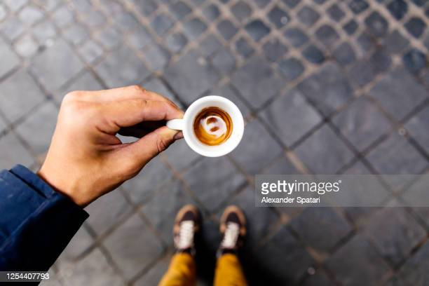 drinking espresso on the streets of rome, personal perspective view - espresso stock pictures, royalty-free photos & images