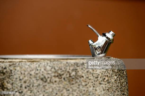 Drinking Fountain Against Wall