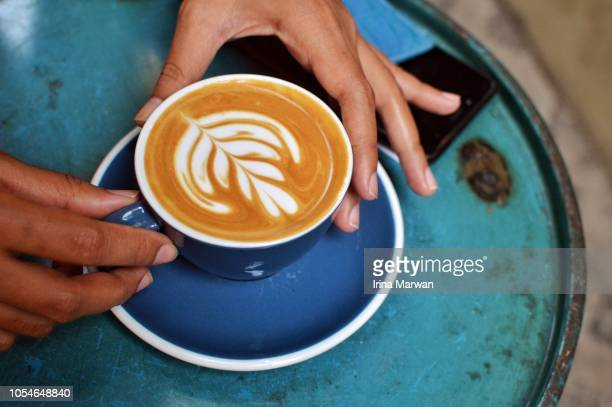 drinking hot coffee - art stock-fotos und bilder