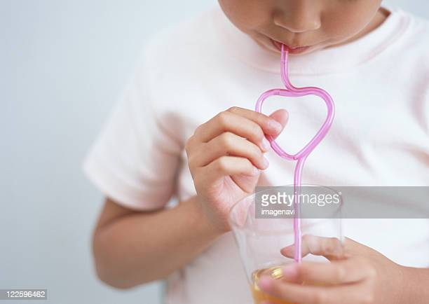 Drinking juice from straw
