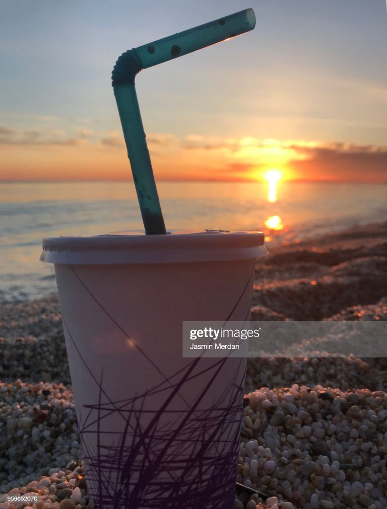 Drinking juice on beach during sunset : Stock-Foto