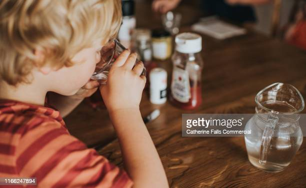 drinking juice - drinking glass stock pictures, royalty-free photos & images