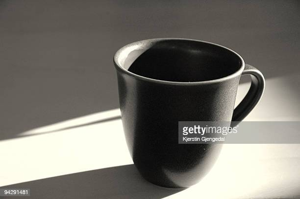 Drinking mug on table in low sunlight