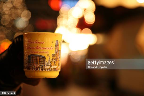 Drinking mulled wine at the Christmas market in Berlin, Germany