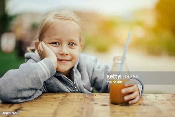 Drinking orange juice