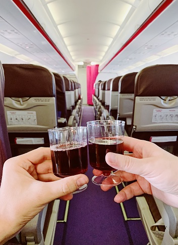 Drinking red wine from plastic cups on a plane - gettyimageskorea