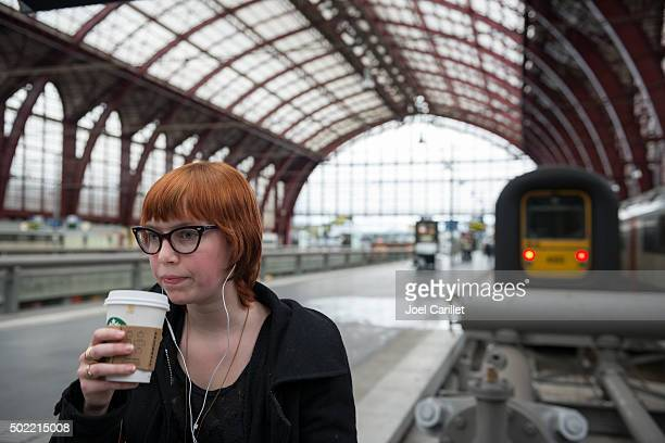 Drinking Starbucks coffee at Antwerp Central Station