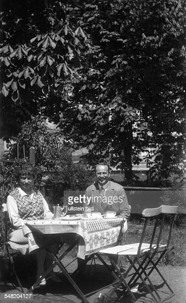 drinking tea / coffee in the garden about 1925