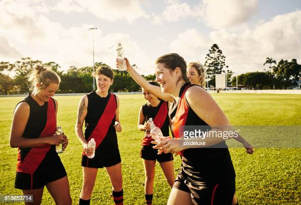 drinking to a good game - afl stock pictures, royalty-free photos & images