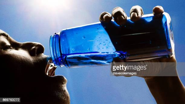 drinking water after exercising - black male bodybuilders stock photos and pictures