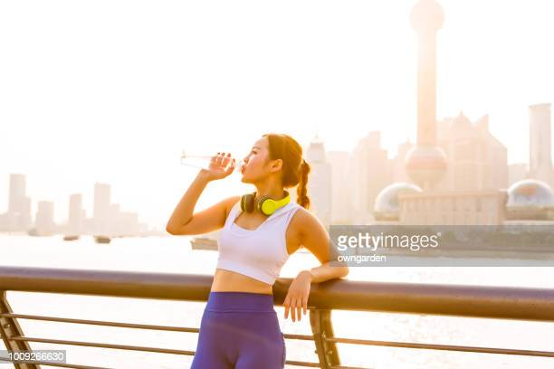 Drinking water after jogging in city