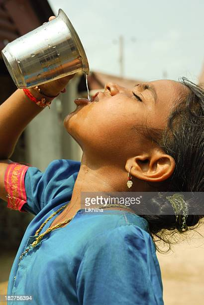 drinking water - hot indian girls stock photos and pictures