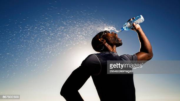 drinking water - men's track stock pictures, royalty-free photos & images