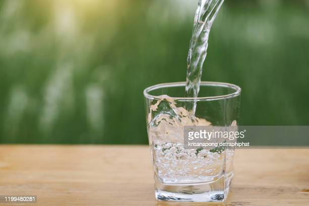 drinking water, water - glass of water stock pictures, royalty-free photos & images
